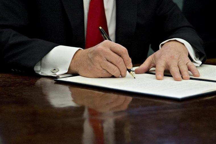 President Trump signing an Executive Order